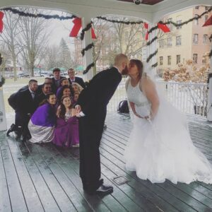 Alyssa on her wedding day leaned over and kissing her husband