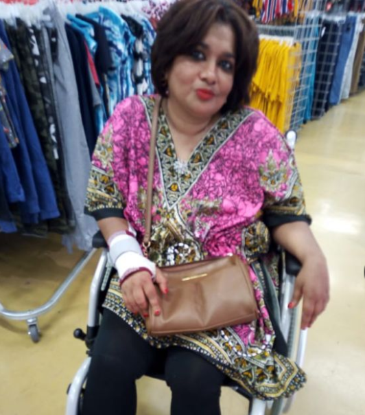 gafsa smiling in her wheelchair