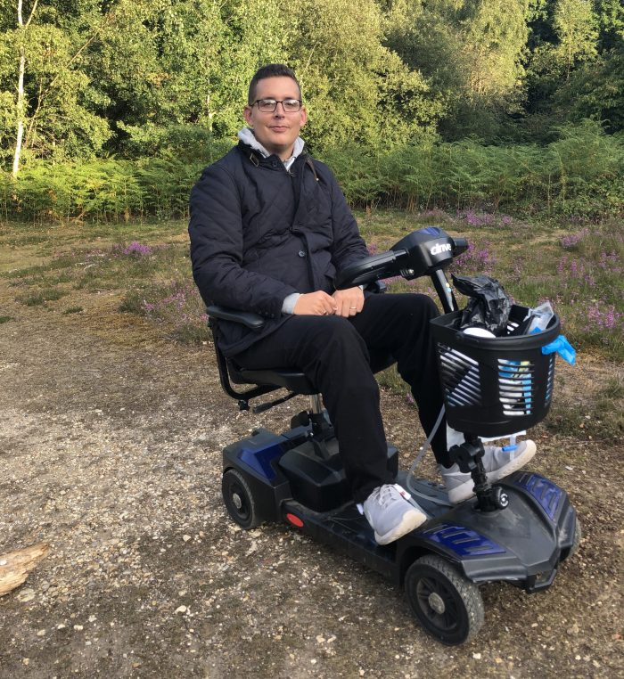 harry sitting on his motorized scooter