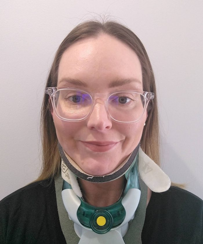 a selfie of a woman wearing glasses and a neck brace