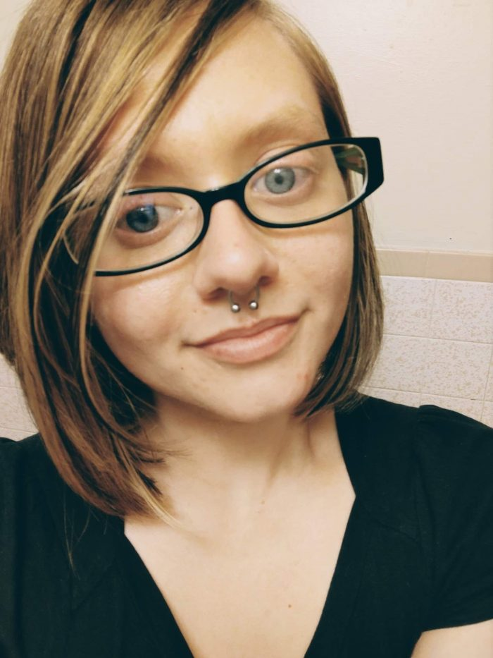 Photo of myself - 29 year old woman with glasses, septum ring, blue eyes and chin length blonde hair
