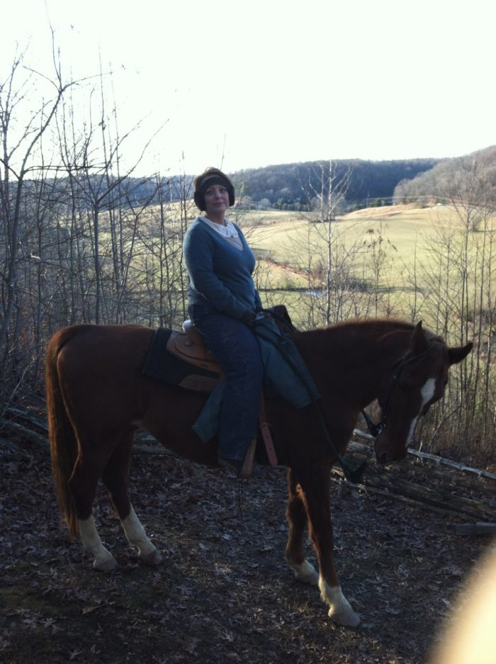 Molly out riding her horse