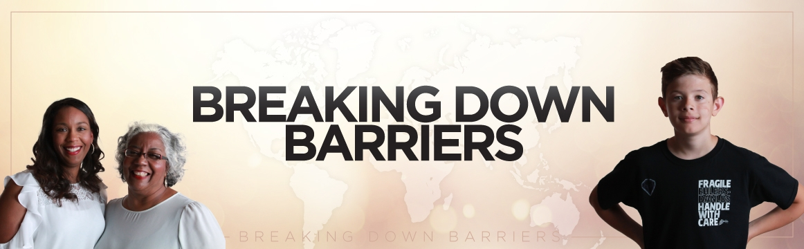 "the banner reads ""breaking down barriers"" with a mother and daughter on the left and a young boy on the right"